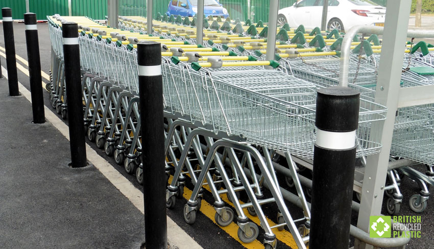 British recycled plastic bollards with steel cores used on the grounds of this Morrisons supermarket