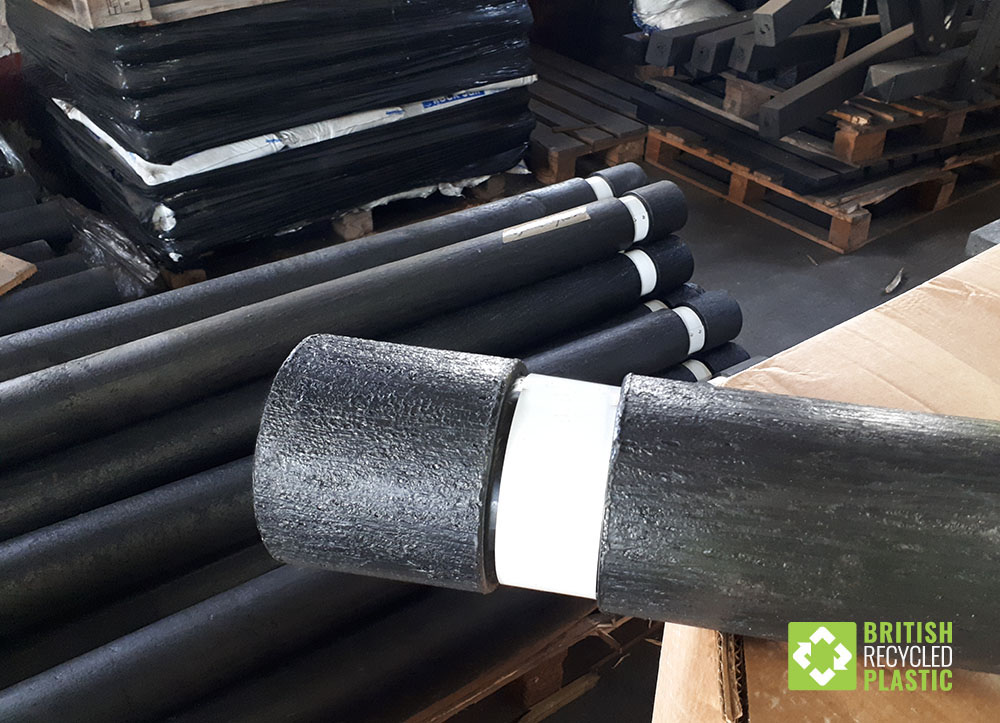Recycled plastic flat topped Halifax bollards with 50mm reflective bands ready for dispatch from the factory