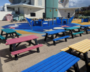 Coloured recycled plastic picnic tables at Bubbles World of Play in New Brighton Beach