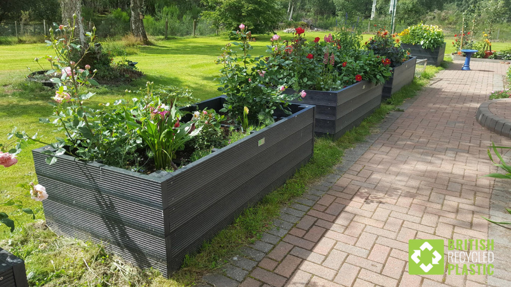 A row of British recycled plastic raised beds in Scotland, all made from the kits we supply