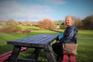 Jackie Swire and a recycled plastic picnic table