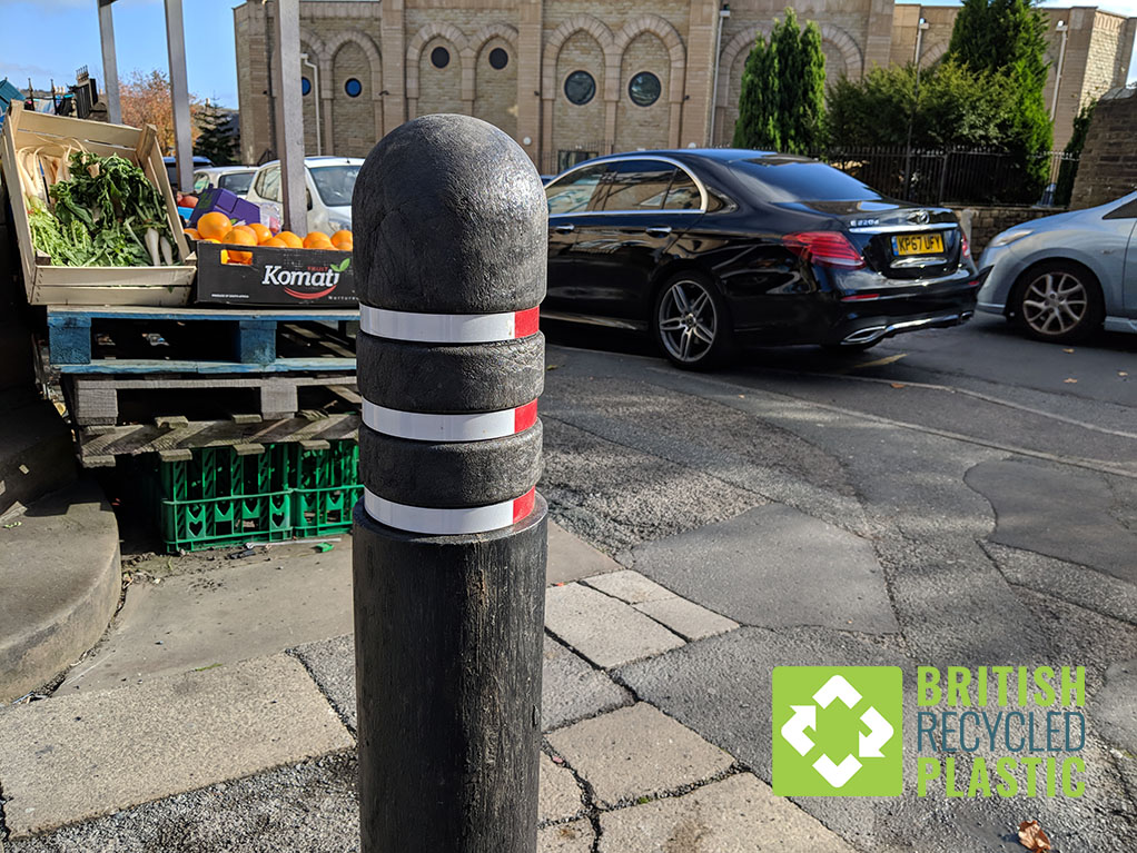 A recycled plastic bollard in Halifax, England. One of many replacing the outdated concrete bollards which have become impractical to replace like-for-like.
