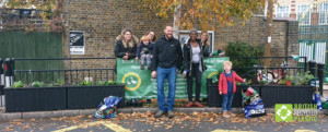 Children and adults pose with Goos Green Primary's new smog shield planters