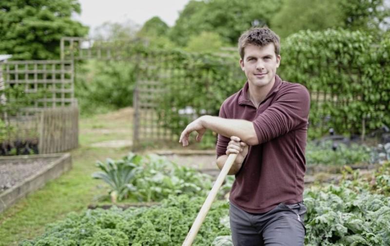 Huw Richards stands in his garden