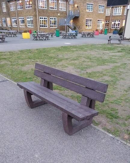 A recycled plastic bench in the grounds of Dartford Grammar School