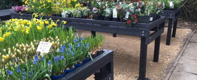 Recycled plastic tables in garden nursery