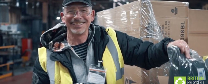 Managing director of British Recycled Plastic helps unbox some of the three million Wetherspoon plastic straws at the recycling plant.