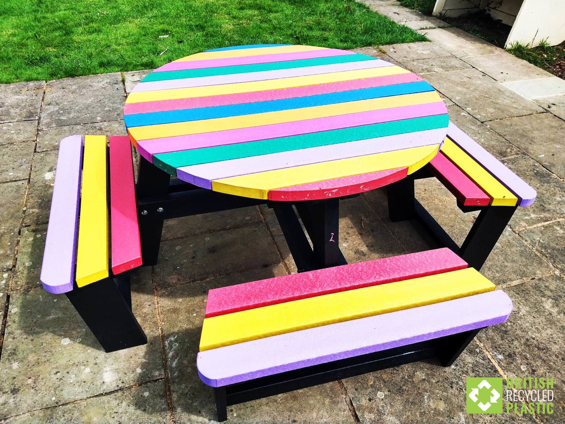 Image of multicoloured round recycled plastic picnic table called the Calder.