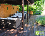 Recycled plastic decking on this beautiful patio is usable all year round and will never rot, split or splinter