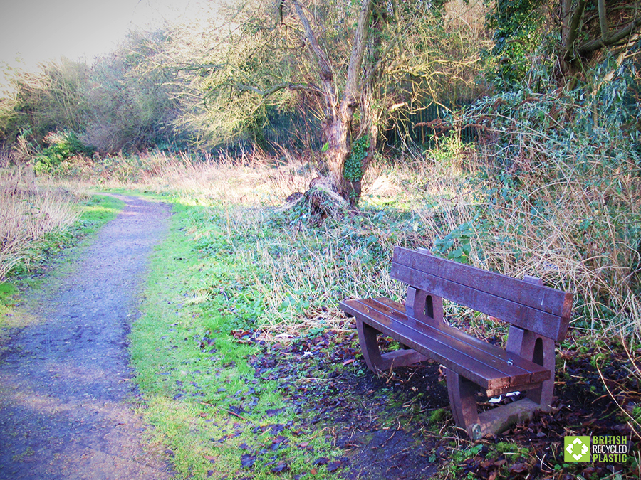 A Harewood recycled plastic bench beside the path at Marconi Ponds, Chelmsford.