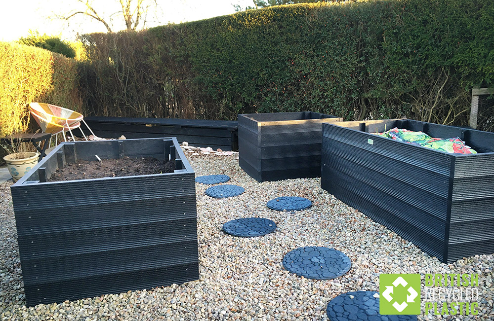 750mm high recycled plastic raised beds, perfect for gardeners with limited mobility, stand waiting for planting