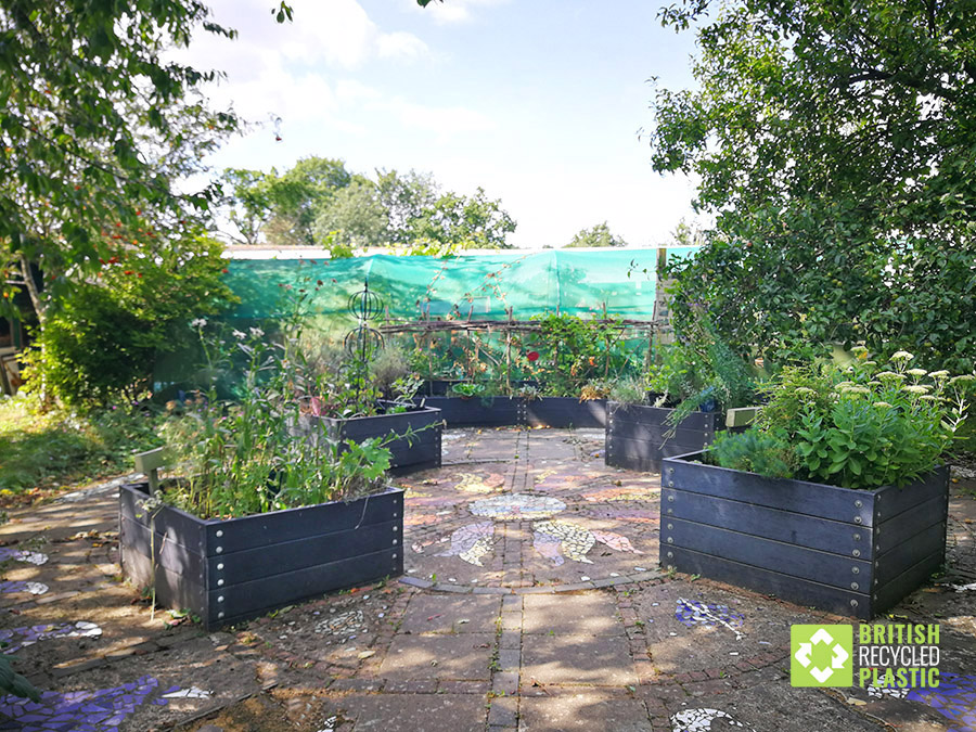 Bespoke recycled plastic raised beds at Earthworks