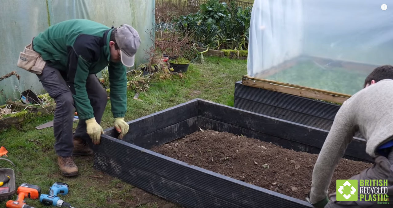 Huw Richards building a recycled plastic raised bed
