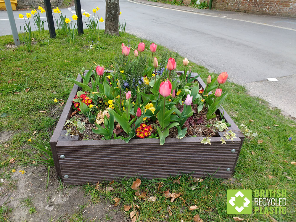 A maintenance-free British Recycled Plastic raised bed forming part of the roadside display for Storrington in Bloom