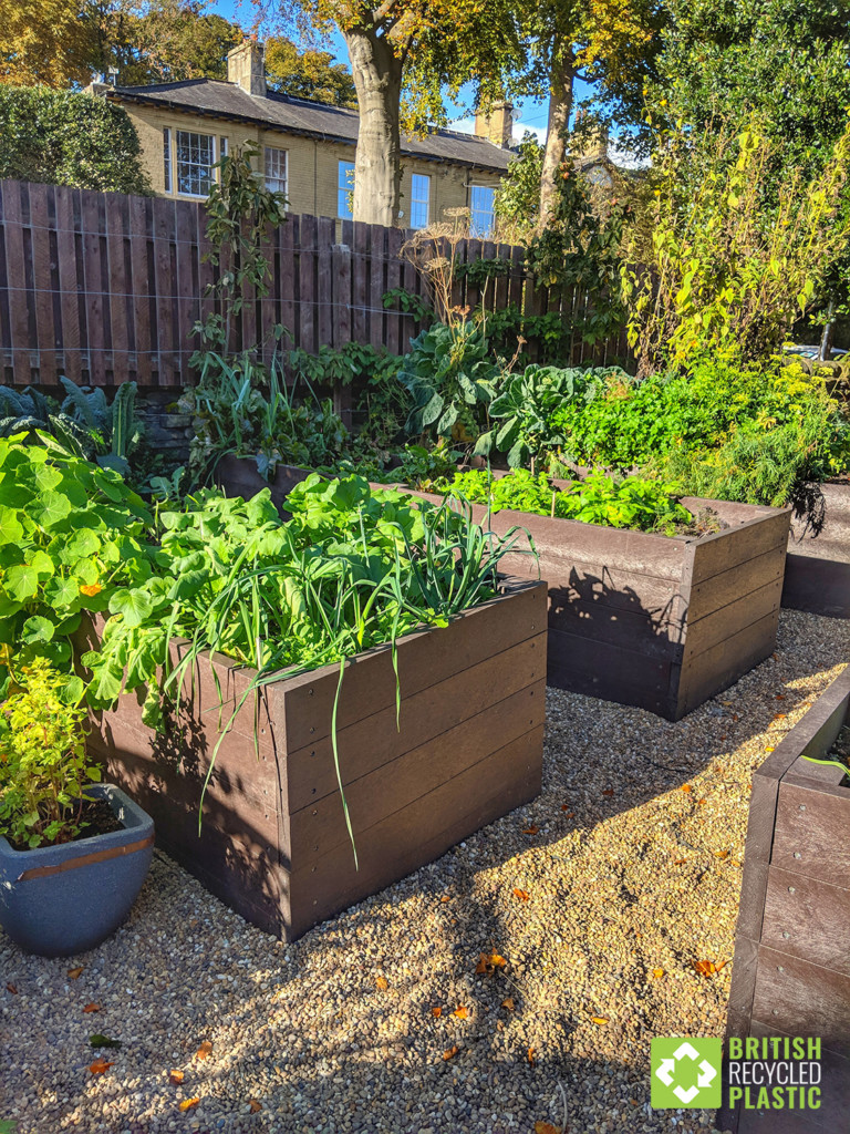 Recycled plastic raised beds in a private garden in Halifax, West Yorkshire