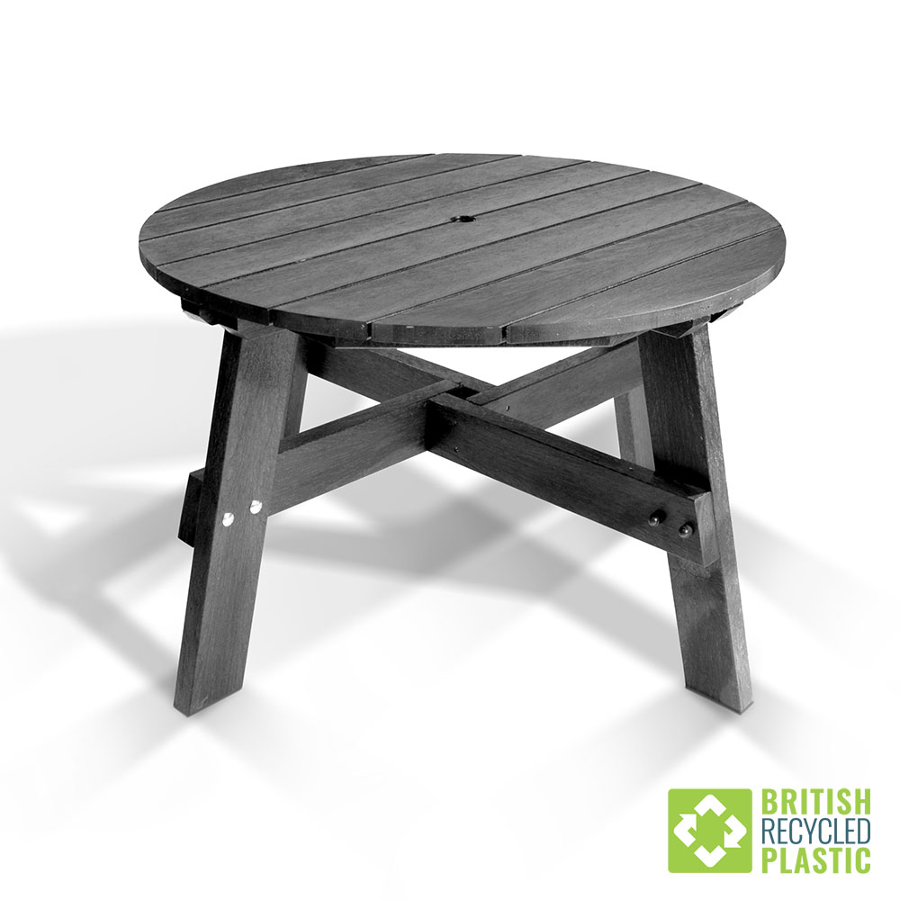 The central round table from the recycled plastic Roundhay Garden Dining Set