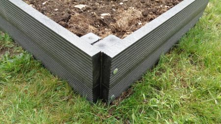 Corner detail of a raised bed showing the steel bolts