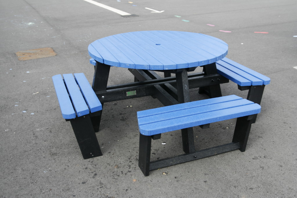 A blue, all weather, Calder recycled plastic picnic table with a 25 year guarantee.