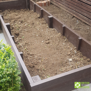 Garden to table growing. 300mm raised bed installation. After filling with compost.