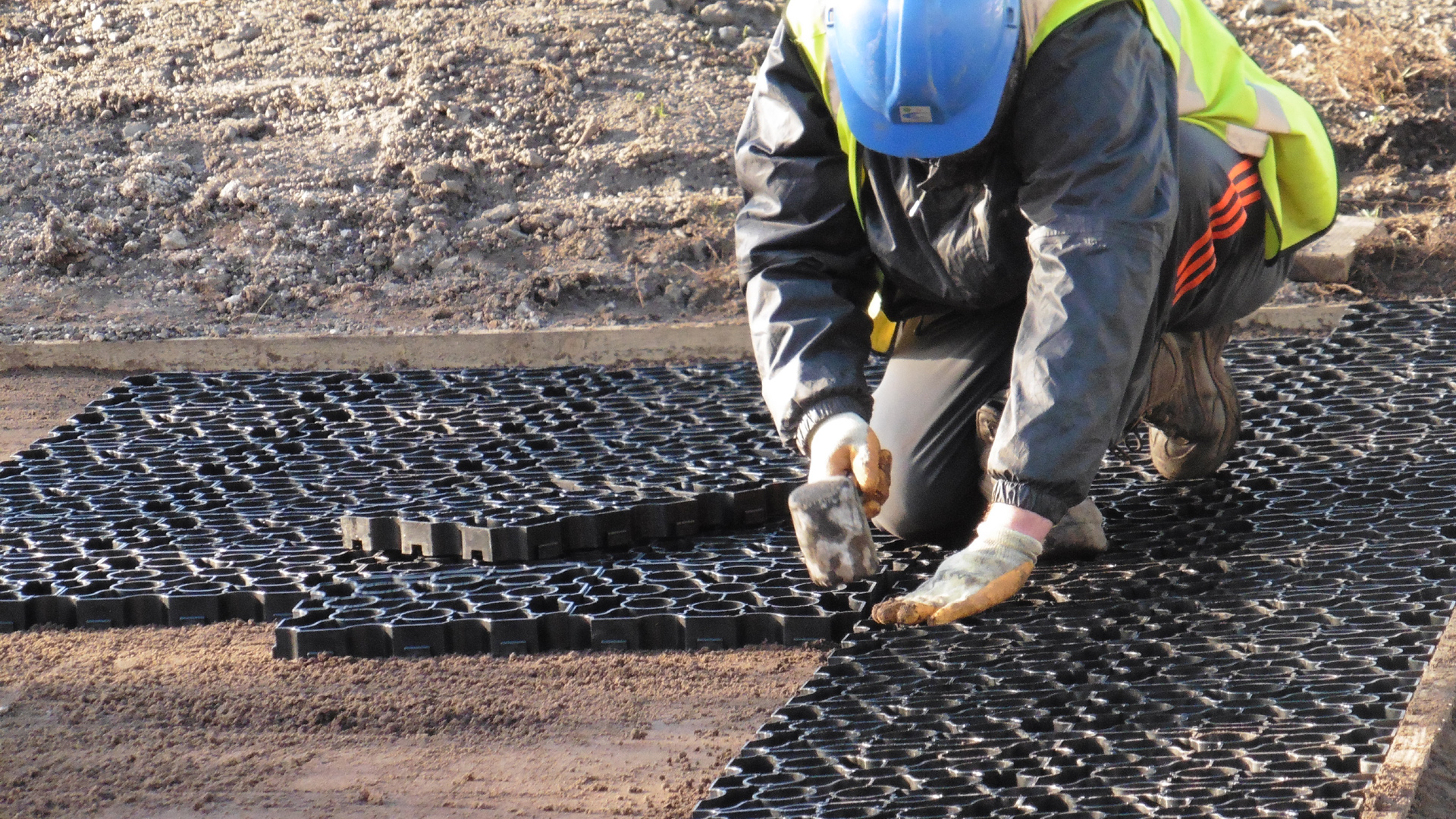 Groundworker installing Hebden X Grids
