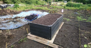 The finished raised bed, filled with topsoil.