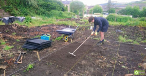 Preparing the ground for the raised beds.
