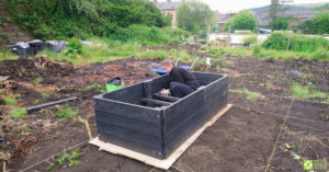 Fitting the cross-supports inside the raised bed.