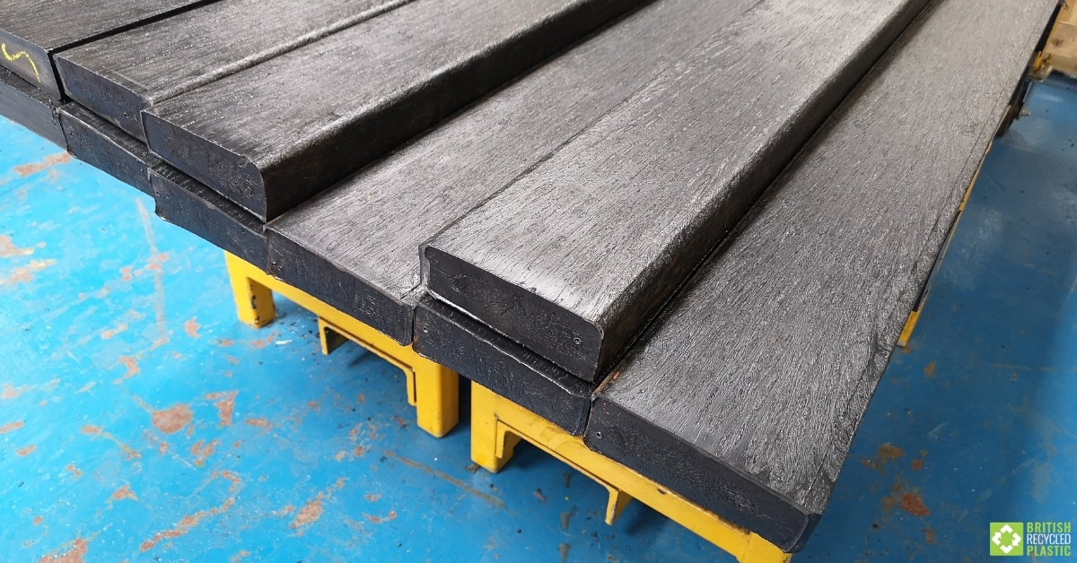 Recycled plastic lumber planks racked up in the factory ready for despatch to customers
