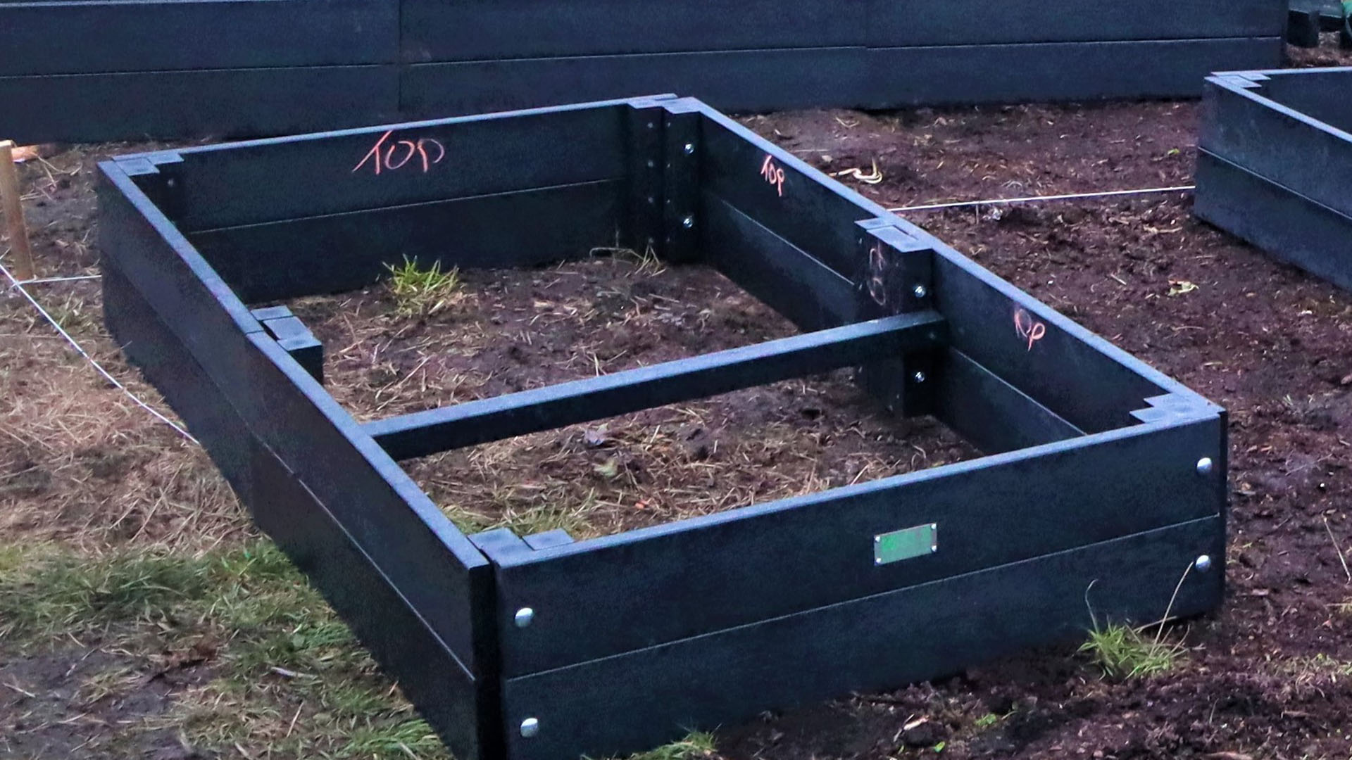 A 2 metre recycled plastic raised bed with the crosstie clearly visible before filling.
