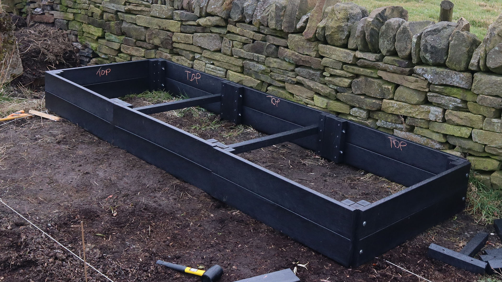 A 3 metre raised bed showing the crossties in place before filling