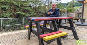 Jason Elliott at a Bradshaw wheelchair-accessible picnic table engineered from British Recycled Plastic
