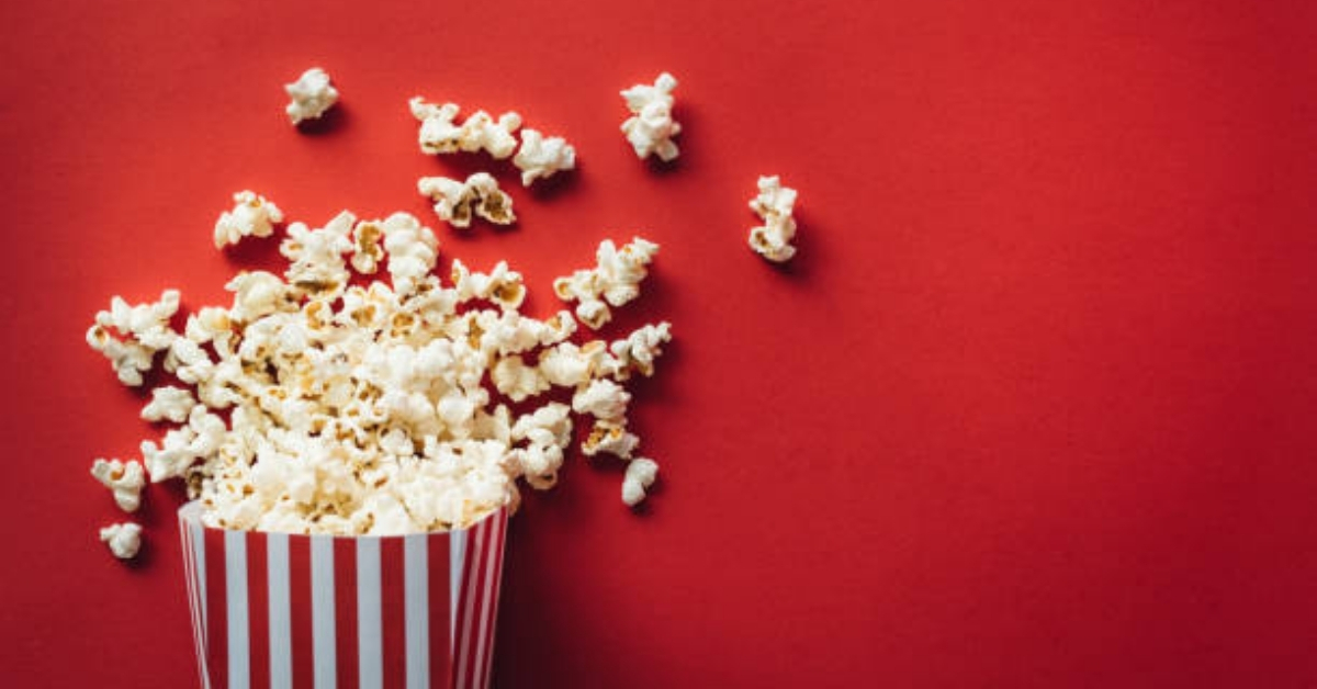 Popcorn against a red background