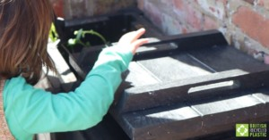 Micro-Callis 500mm composter with child peeping in, close crop