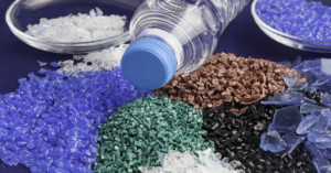 Variety of plastic pellets with a plastic water bottle