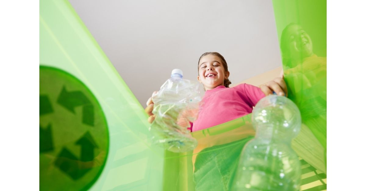 Young girl recycling plastic empty plastic bottle
